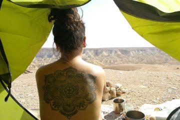 back tattoo in a tent