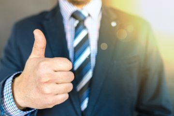 man in a suit thumbs up